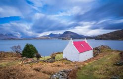 Red roof cottage by Loch Shieldaig, Scotland Stock Photo