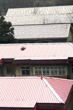 Red roof covered with snow Stock Images