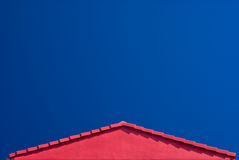 Red Roof Gable and Blue Sky Royalty Free Stock Photos
