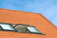 Red roof of house Stock Images