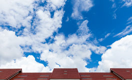 Red roof of house against blue sky Royalty Free Stock Photos