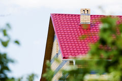 Red roof house on a background of the summer sky Royalty Free Stock Photos