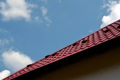 Red Roof. The house has a new roof tile red metal. Beautiful blue sky seen royalty free stock photos