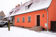 Red roof house in the winter season Royalty Free Stock Images