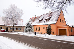Red roof house in the winter season royalty free stock photography