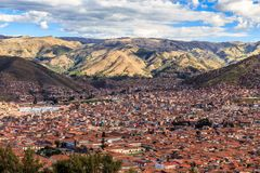 Red roof houses of Cuzco city in the valley and Andes panorama, Stock Images