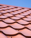 Red roof of metal roofing on the sky background. Red roof of metal roofing on the sky Stock Photos