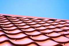 Red roof of metal roofing on the sky background Royalty Free Stock Photos