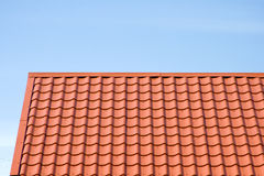 Red roof of metal roofing on the sky background Royalty Free Stock Image