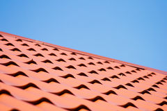 Red roof of metal roofing on the sky background Stock Image