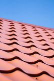 Red roof of metal roofing on the sky background. Red roof of metal roofing on the sky Royalty Free Stock Images