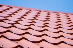 Red roof of metal roofing on the sky background. Red roof of metal roofing on the sky Royalty Free Stock Photography