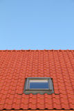 Red roof with one vertical windows Royalty Free Stock Photos