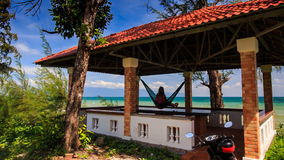 Red Roof Pavilion with Girl in Hammock is on High Beach stock footage
