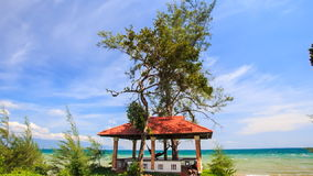 Red Roof Pavilion with Hammock on Beach against Azure Sea stock video footage
