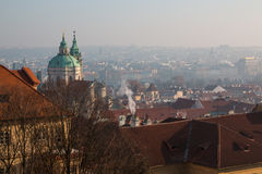 The red roof in Prague. Panoramic view of Prague in winter day with dense fog in the city. Stock Photo