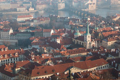 The red roof in Prague. Panoramic view of Prague in winter day with dense fog in the city. Royalty Free Stock Images