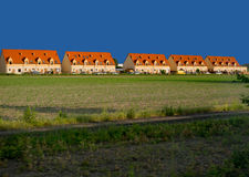 Red roof same buildings. Front of farming field royalty free stock photography