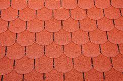 Red Roof Shingles. Red toned roofing shingles. Texture Stock Photography
