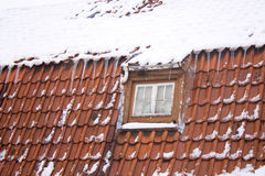 Red roof with snow Royalty Free Stock Images