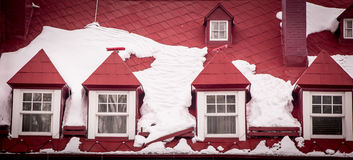 Red roof with snow Stock Images