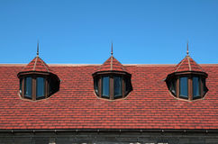 Red roof with three dormers Royalty Free Stock Photography