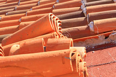 Red roof tile Installation. Red roof tiles being installed on a hot day. Made in Mexico Stock Image
