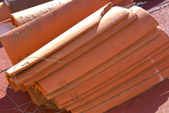 Red Roof tile. S being installed by contractor  on a hot day. Tiles are made in Mexico Stock Images