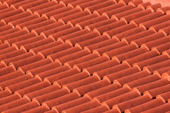 Red roof tiles. Red painted roof tiles background Stock Photos