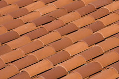 Red Roof Tiles. The diagonal pattern of red tiles on a roof Stock Images