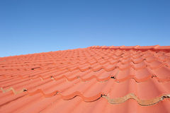 Red roof tiles blue sky background Stock Photo