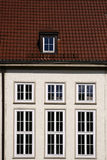 Red roof tiles and high windows Royalty Free Stock Photo