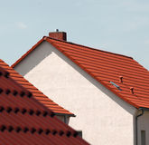 Red roof tiles on houses Stock Photos