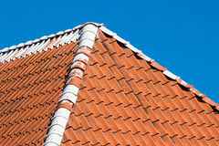 Red roof tiles with sky Stock Photography
