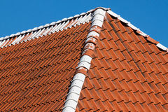 Red roof tiles with sky Royalty Free Stock Photography