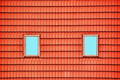 Red roof and two windows Royalty Free Stock Photos