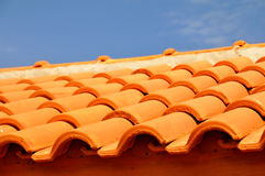 Red roof under the blue sky Stock Image