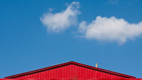 A red roof under the blue sky Royalty Free Stock Photo