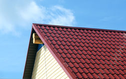 Red roof and wall on country house closeup Stock Photo