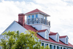 Red Roof with Widows Walk and Dormers Stock Images