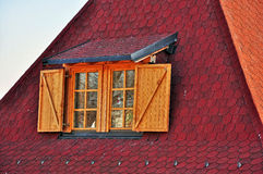 Red roof with window Stock Image
