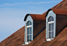 Red roof and windows Royalty Free Stock Photos