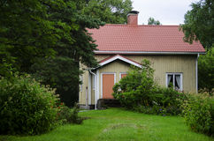 Red roof wooden Finnish house Royalty Free Stock Photography