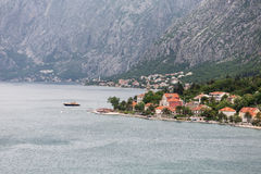 Red Roofed Buildings and Church Tower in Kotor Stock Photos