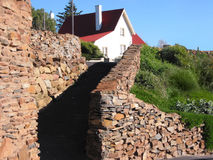 Red roofed house. Stack-stone walled pathway leading up to a red-roofed house. Tasmania, Australia. Tasmanians seem to be almost obsessive about stacking things Royalty Free Stock Photo