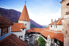 Red roofs of Bran Castle in inner yard, Romania Stock Photos