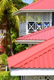 Red roofs on caribbean hotel. Red roofs on caribbean resort buildings with Palms in background royalty free stock images