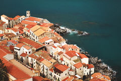 Red roofs in Cefalu. View on old red roofs in Cefalu city. SIcily island, Italy, Europe. Shore of mediterranean sea Stock Photo