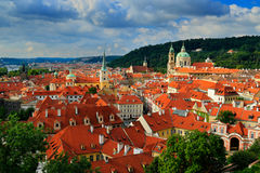 Red roofs in the city Prague. Panoramic view of Prague from the Prague Castle, Czech Republic. Summer day with blue sky with cloud Stock Images