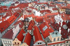 Red roofs of houses in Prague. Red roofs of houses create a triangular geometric pattern. A view from above of a part of the city of Prague in the Czech Republic Stock Image
